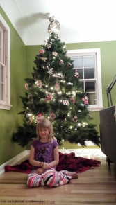 Posing in front of the Christmas tree